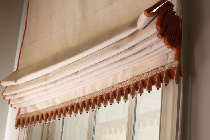 Straight Roman Shade With Decorative Trim On Sides And