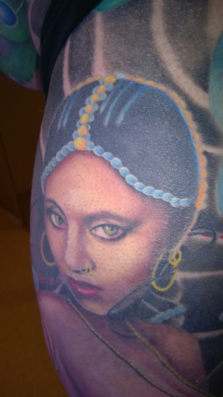 Portrait inspired by Bollywood actress Urmila Matondkar, tattooed on left leg as part of a full body suit, by Patrick McFarlane, Black Freighter Tattoo Studio, Chester, UK