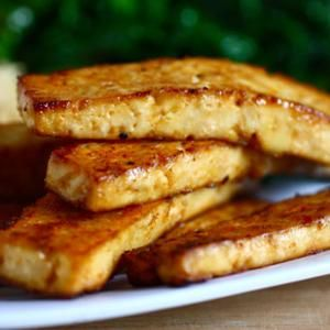 "Asian Baked Tofu: 16 oz. extra firm tofu, cut into thin 1"" slabs, 2 tbsp. sesame oil, 2 tbsp. soy sauce, 1 tbsp. rice vinegar, 3 tsp. maple syrup, 1 tsp. sriracha sauce, pinch of garlic powder, onion powder and sea salt"