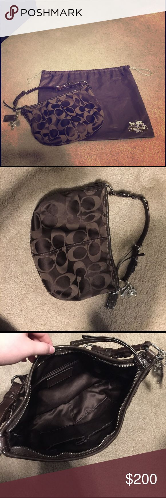 Coach brown Hobo bag Beautiful brown Coach hobo bag with gorgeous carriage bag charm.  Brown interior with minor signs of use. Comes with original dust bag Coach Bags Hobos