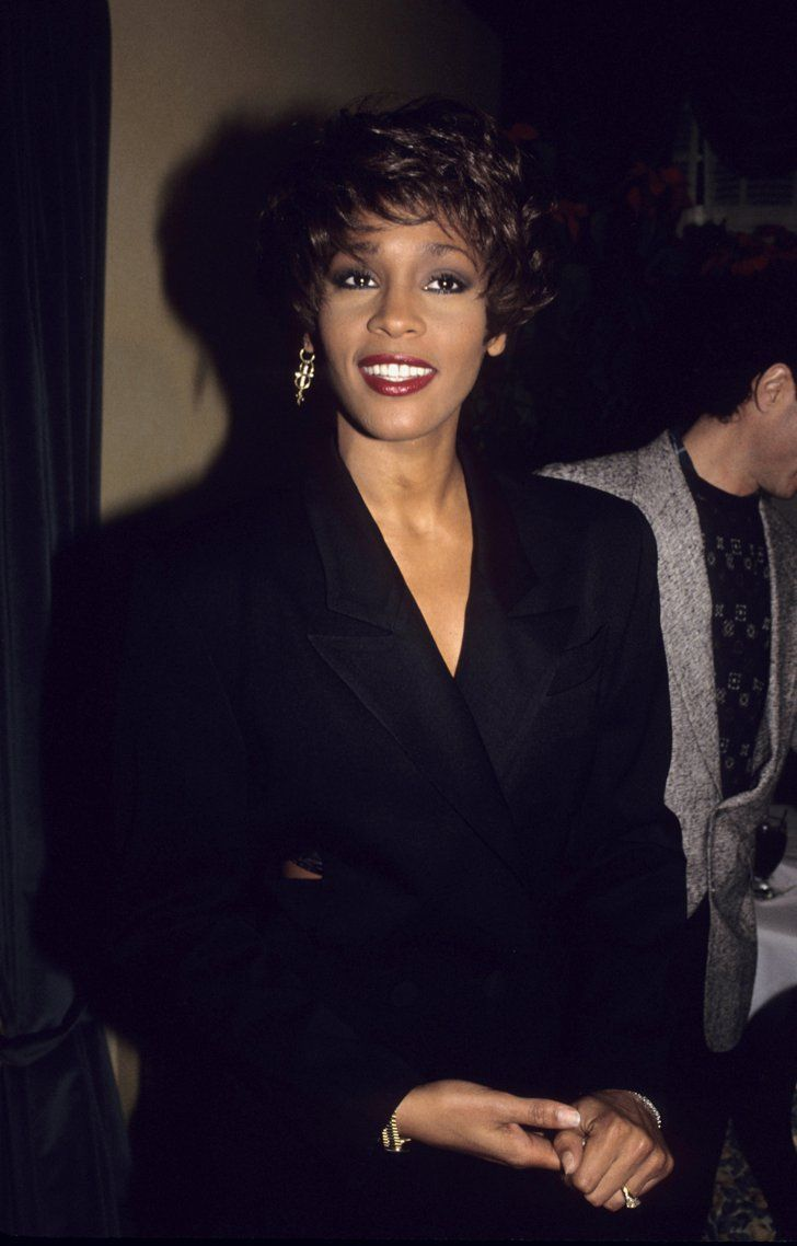 Pin for Later: Remember Whitney Houston With a Look at Her Life in Pictures  She smiled big in 1990.