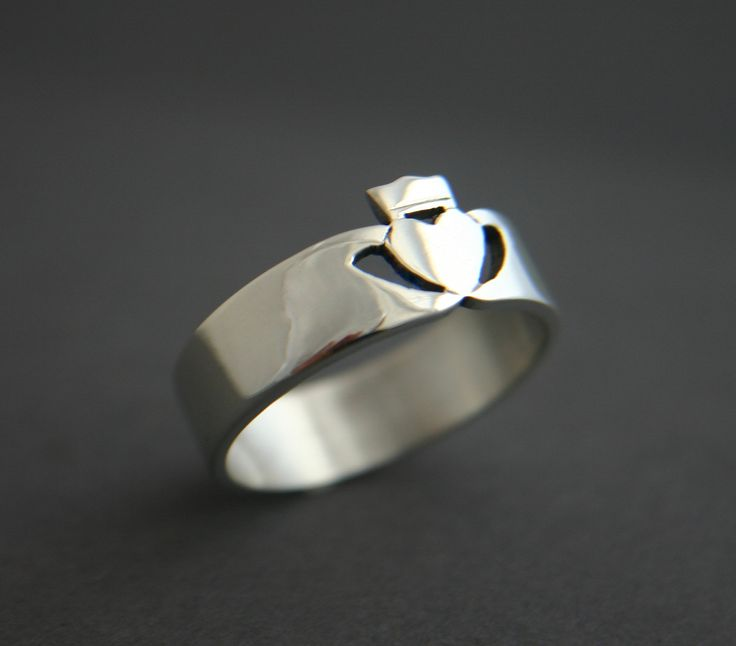 Silver Mens Contemporary Irish Claddagh Ring (for him) $165 Hands represent friendship, heart represents love, and crown represents loyalty.