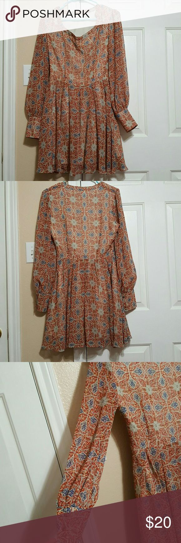 Asos Petite Dress size 6 Asos Petites size 6 dress. Long-sleeved and very lightweight and great for spring. Fully lined  with sheer sleeves. Side zipper. 100% polyester. Machine wash inside out with like colors. From a smoke-free environment. All sales final. Make an offer! ASOS Petite Dresses Long Sleeve