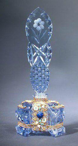 Glass lite blue carved old bottle