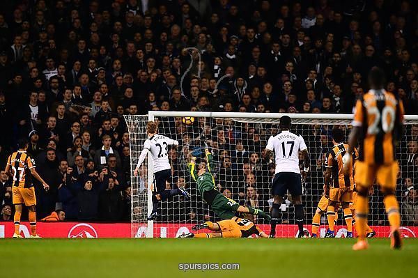 LONDON, ENGLAND - DECEMBER 14: Christian Eriksen of Tottenham Hotspur (L) scores his sides first goal during the Premier League match between Tottenham Hotspur and Hull City at White Hart Lane on December 14, 2016 in London, England