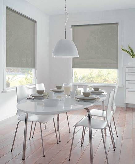 Roller screens can be used to control light and add a hint of colour to an all white room.