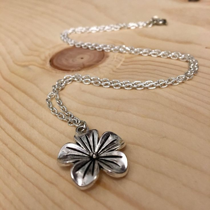 Pewter Silver Flower Pendant Necklace  https://www.etsy.com/ca/listing/570476219/silver-flower-pendant-necklace