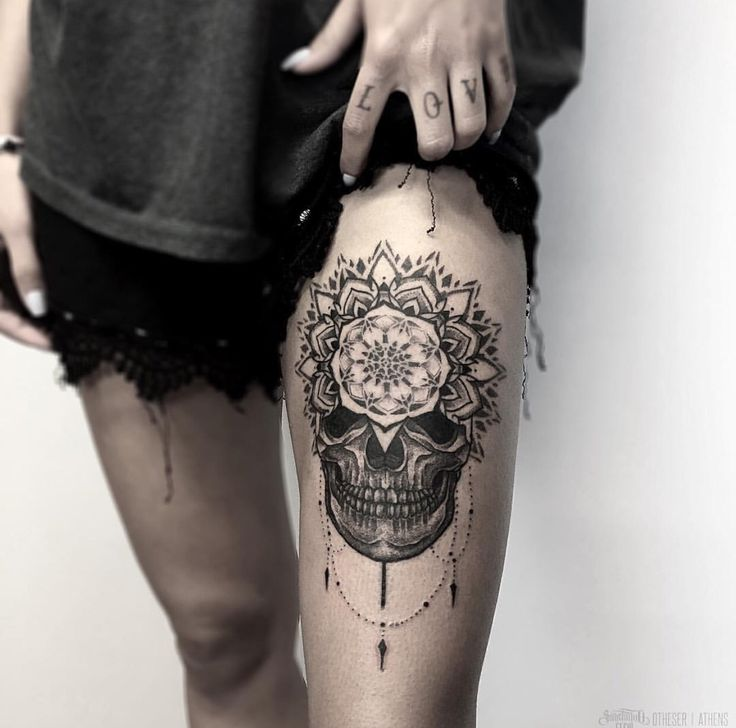 Mandala skull tattoo on thigh. I like the placement!
