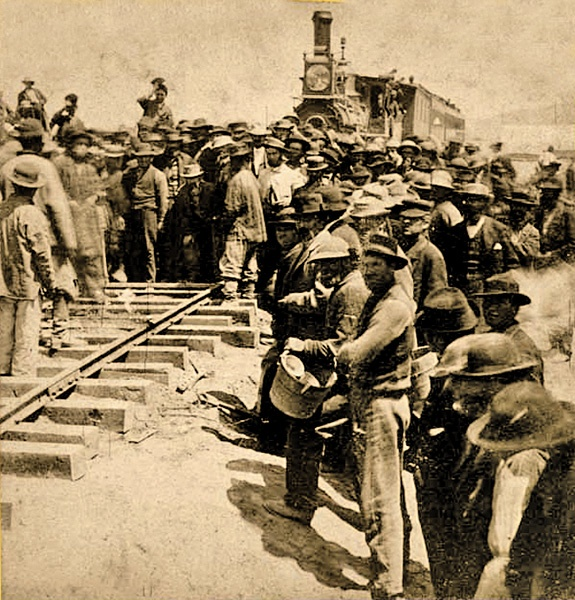 """When the railroad was completed on May 10, an eight-man Chinese crew was selected to place the last section of the rail, to pay tribute to the hard work of the Chinese laborers. A.J. Russell photographed the only known record of the Chinese role in the """"Last Rail"""" ceremony."""