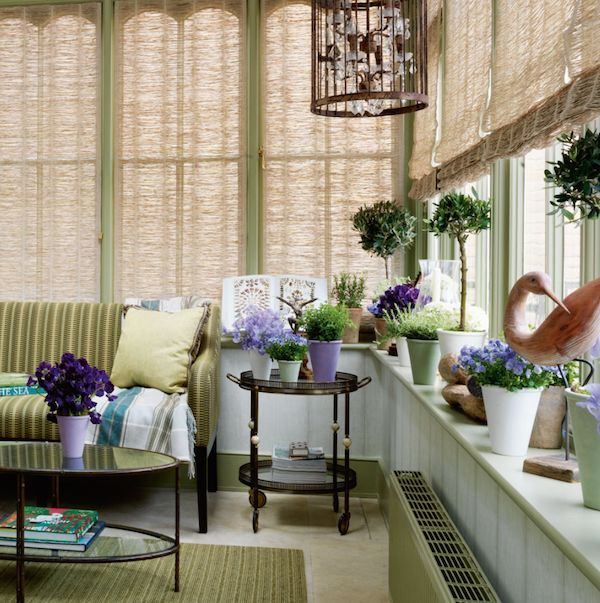 The round coffee and end tables, the blinds, the greenery, the area rug. This living room has both style and class.