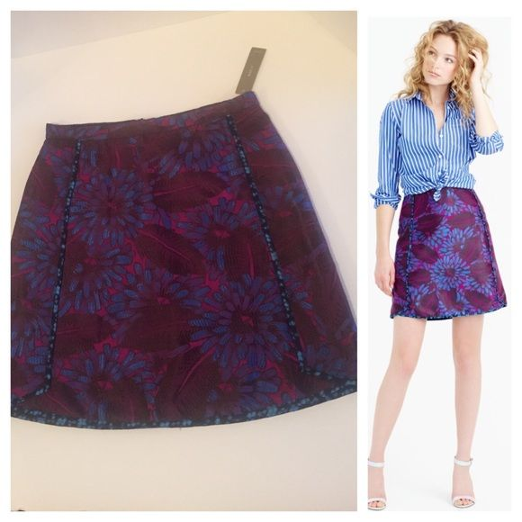 "J Crew Purple & Blue Midnight Floral Skirt Floral jacquard mini skirt in deep hues of purple and blue. Contrast piping and a shirt tail hem. A polished look for brunch or a day in the office. Back zip. Lined. Sits at waist  18.5"" long. Waist measures 14"", lying flat. Hips are 19"". SOLD OUT. Brand new with tags! J. Crew Skirts Mini"