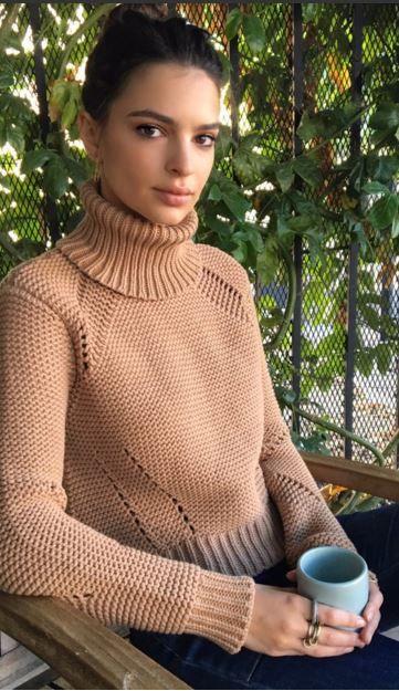 Who made Emily Ratajkowski's blue jeans and tan sweater?