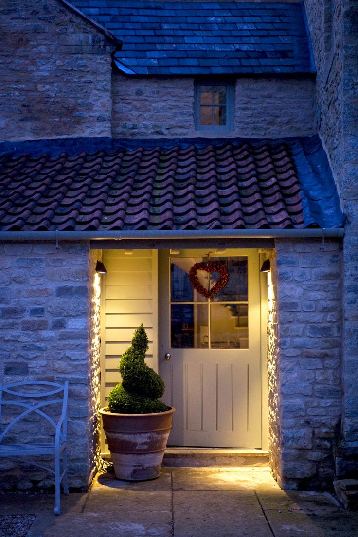Recessed back door entry would protect from snow blowing into doorway Wiltshire barn renovation, England. Sims Hilditch.