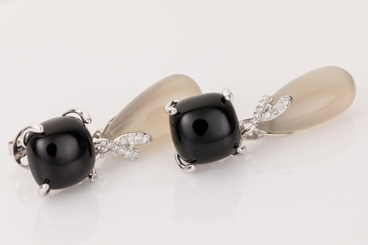 Black Onyx, chalcedony and a sprinkling of white diamonds. 18k white gold drop earrings looks super on the ear. The chalcedony drop has a grey translucent appearance suspended from the black onyx with a twist of white diamonds. Available from www.1stdibs.com
