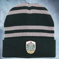 """$12. """"This hat is made of acrylic and features the Slytherin House Coat of Arms patch. This officially licensed piece is a great addition to any Harry Potter ensemble."""""""