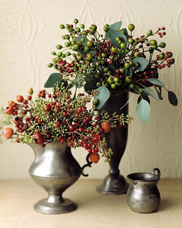 Rose Hip Arrangement  Rose hips mixed with eucalyptus fruit and leaves in pewter vessels put on an ebullient show.