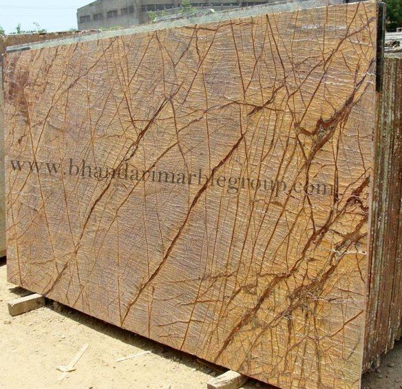 Rainforest Brown  Brown Marble is gorgeous and, looks wonderful after all finishing has been done, Marble can be use as wall cladding, bar top, fireplace surround, sinks base, light duty home floors, and tables.