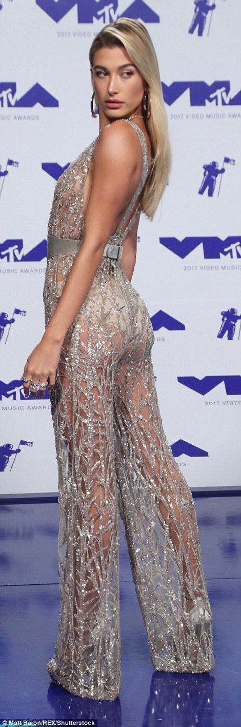 Wow factor: She proudly showed off her backside as she teamed the racy look with metallic silver heels