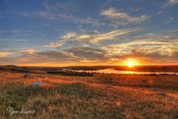 sunset along the South Saskatchewan river and riverhills near Estuary