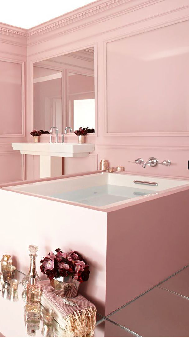 I always vowed to not make a bathroom pink, but if you are going to you should just go for it, like this space!