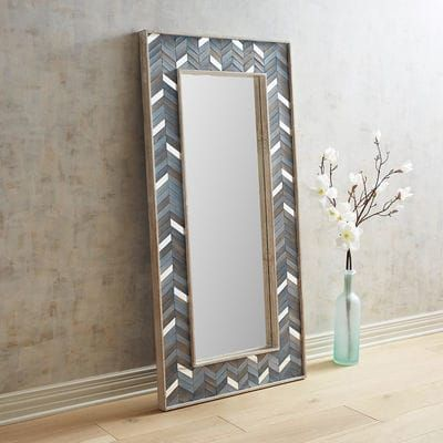 With its strong lines and textural composition, our striking chevron mirror blends both modern and rustic sensibilities with a substantial amount of style. Each piece around the frame has been hand-painted and inlaid so no two mirrors are exactly alike.