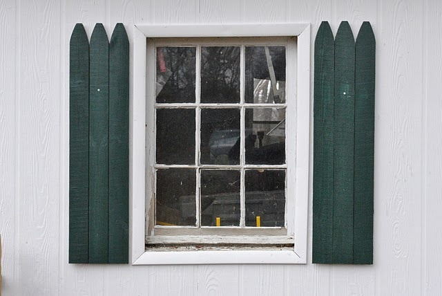Picket Fence Shutters Around Her Window Make The Inside