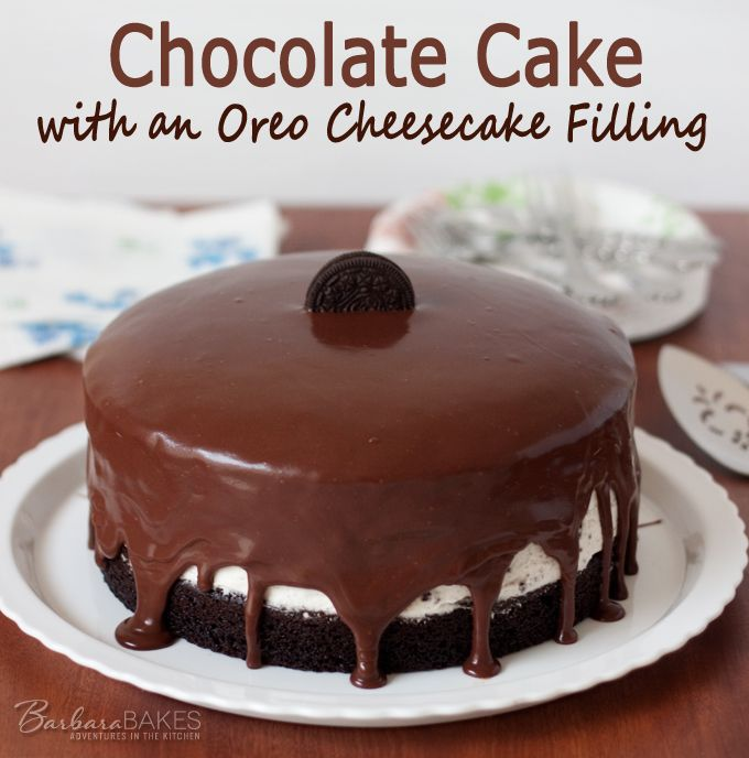 An easy-to-make, creamy no-bake Oreo cheesecake filling sandwiched between rich, moist chocolate cake dripping with a milk chocolate ganache.