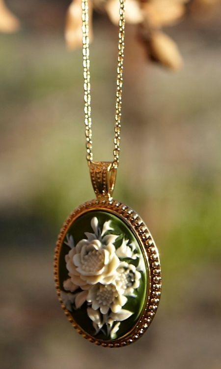 Green cameo necklace by Shabby Apple - I have a soft spot for cameos, and green? Oh, it's lovely!