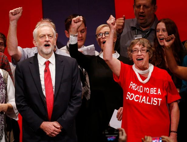 Jeremy Corbyn joined by a choir on stage to sing The Red Flag at Labour Party Conference