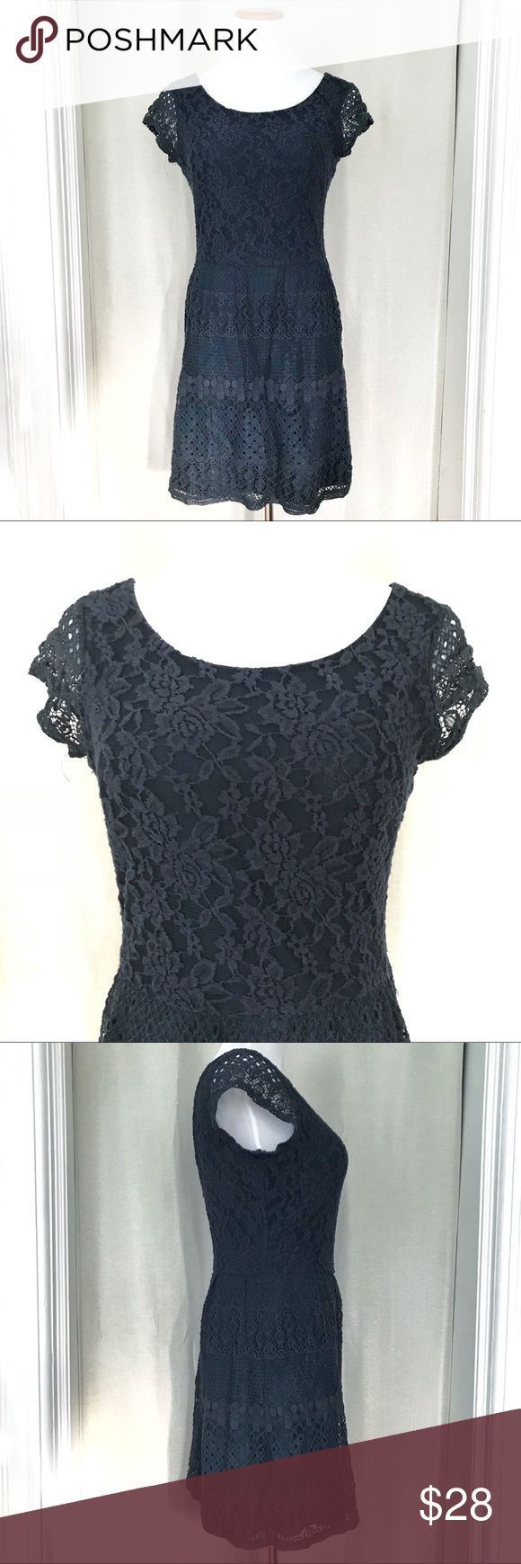 Cute Navy Lace Dress Cute Navy Lace Dress gently worn in great condition. Scoop neckline with cute cap sleeve details. Back zip closure with V shaped back. Hemline ends just above knee. Bought in Japan will fit a slim 6 and a regular size 4. Beautiful floral lace design makes this a cute everyday dress. Dresses Mini