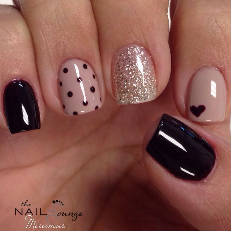 glossy glam nail art with polka dots glitter and black heart symbol