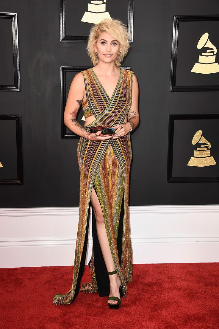 Paris Jackson Looks Incredible on the Grammys Red Carpet:  An appearance by Paris Jackson, who showed off a rainbow Balmain jumpsuit and a short, shaggy, platinum 'do. The girl just looked so. freakin'. good. Is Michael Jackson's daughter ready to break out as the next big thing? This look—and her Rolling Stone cover and upcoming acting gigs—has us thinking hell yes. | coveteur.com