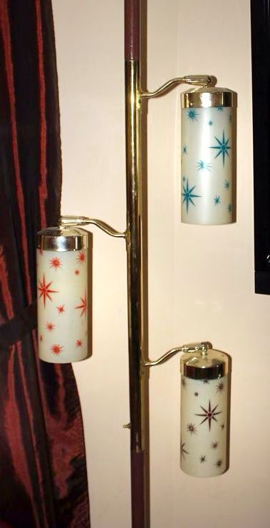 Mid century starburst tension pole lamp.