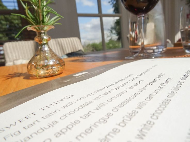Perusing the menu in The Conservatory Restaurant at Calcot Manor Hotel & Spa on a Summer's day. #Cotswolds http://www.calcotmanor.co.uk/dining-at-calcot/conservatory/