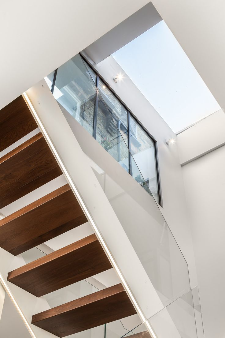 Basement access floating stairs with rooflight above. Design by EMR Home Design. www.emrdesign.co.uk