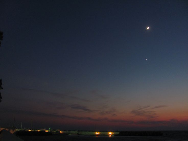 Zushi Marina and crescent moon.
