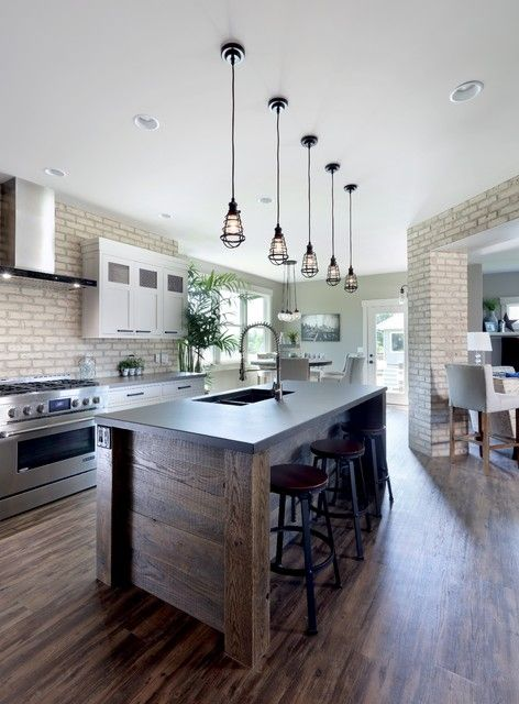 This is an example of an industrial l-shaped kitchen in Grand Rapids with a…