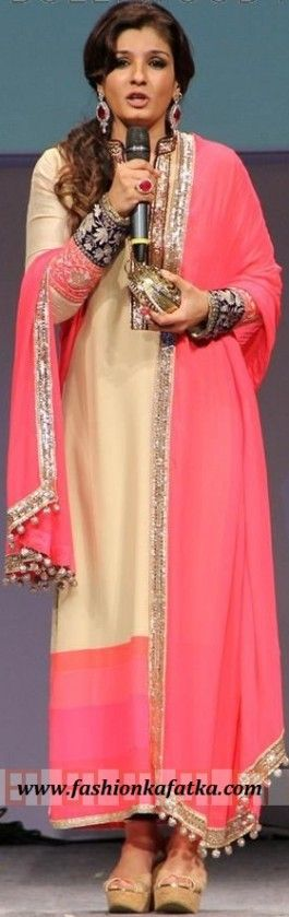 What a charming look Raveena Tandon has created by wearing Long #Salwar #Kameez Suit! FKF enables you to do the same for you when you're embellishing a grand party