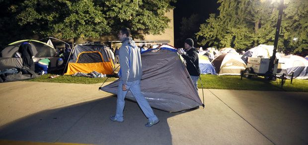 Campout starts after frantic dash for space to wait for Kentucky basketball Madness tickets | Basketball: Women | Kentucky.com  I was wondering what this was for. Someone thought it was for the new iPhone. They've been outside my dorm for 3 days now ands already been bugging and messing up with campus life. People left their jobs and took their kids out of school for tickets. I don't see the point and I wonder how people rationalize this