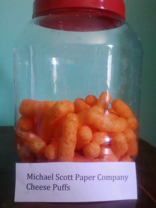 """The Office"" Party Food: Michael Scott's Paper Co. cheese puffs. Other food ideas: Jim's ""Big Tuna"" Sandwiches, Stanley's Free Pretzels"