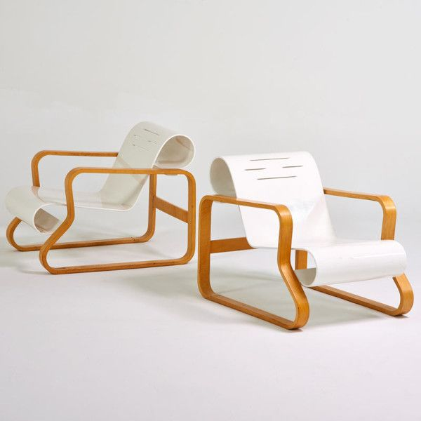 "Lot No. 554 Alvar Aalto pair of ""Paimio"" lounge chairs, Finland, 1980s; Enameled seats, birch frames; Unmarked"