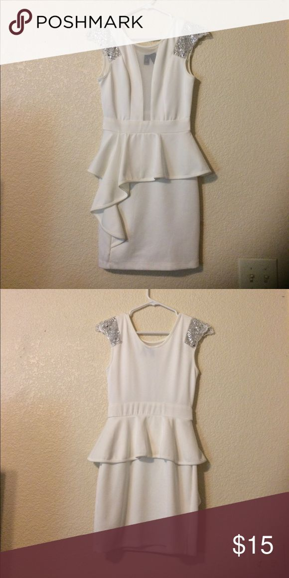 Small White peplum dress with beaded shoulders Women's small white (off white) peplum dress with headers shoulders and illusion plunging neckline. I've worn this twice to formal events, it is in great condition. WINDSOR Dresses