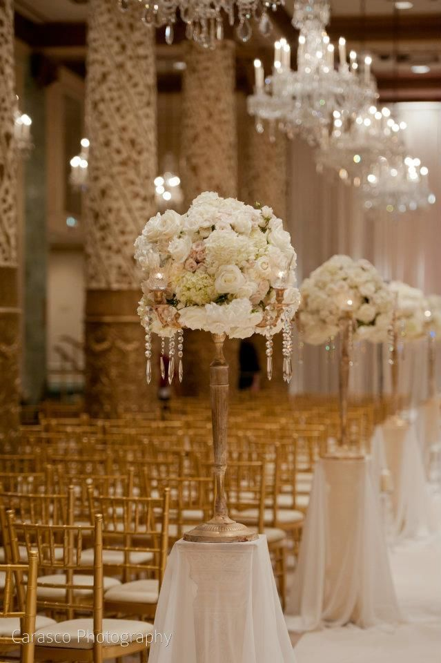 large topiaries' & chandeliers lining up the aisle <3