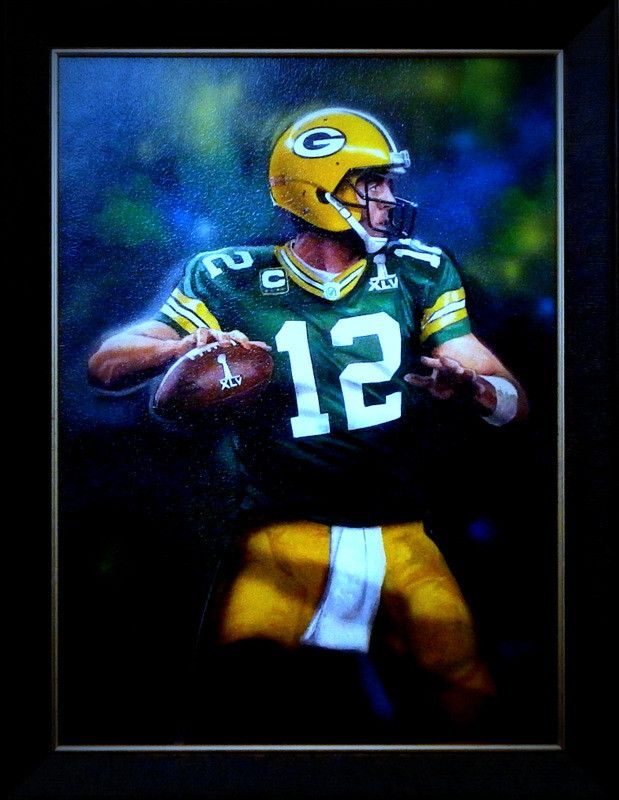 Charles Freitag has painted a great image of Aaron Rodgers #12 of the Green Bay Packers football team. OUT OF THE SHADOW must mean he no longer plays as back-up to Favre. This is an open edition frame
