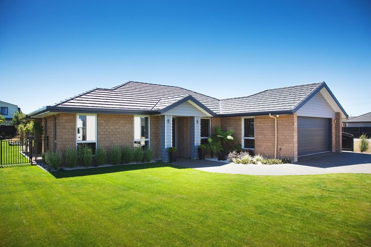 The view from outside. Light blue weatherboard combines beautifully with the light bricks.