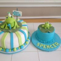 Frog Cakes   First birthday frog cake with coordinating smash cake. The fondant frogs were so much fun!!
