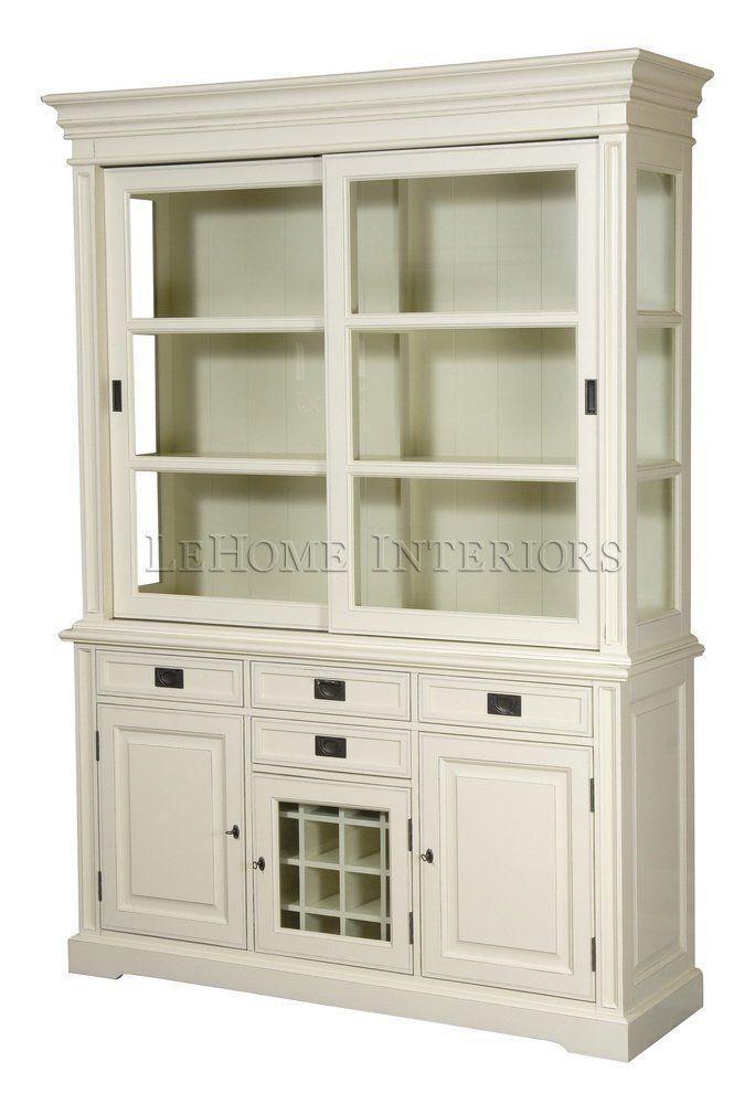 Шкаф  Keywest Oak Cupboard. Кухонный шкаф для хранения. Имеет раздвижные верхние стеклянные и нижние дверцы. Внизу отделение для хранения бутылок. Выдвижные ящики оборудованы доводчиками. Врезные ручки из латуни в морском стиле.