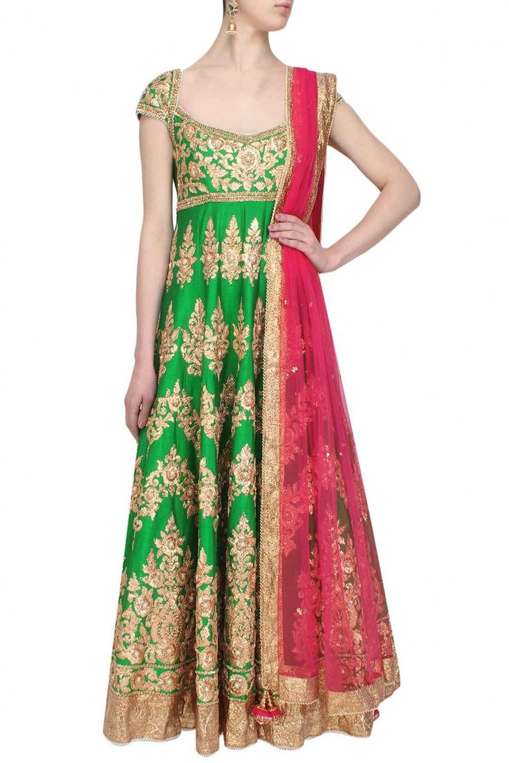 This green anarkali is made in raw silk base appliqued with floral pattern gold…