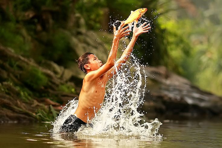 Catching A Fish by Rizal Arnex A rural area of Jakarta, Indonesia.