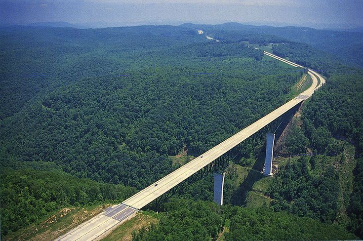 "Phil G McDonald Bridge--""World's Highest Truss Bridge""--Glade Creek Bridge  Beckley, West Virginia, United States  700 feet high / 213 meters high  784 foot span / 239 meter span  1988--Distinguished by it's bright green paint."